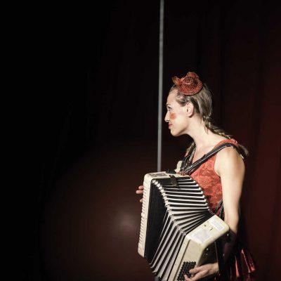 Clown musical act, traditional style circus act: Walking globe, hula hoops, accordion & unicycle